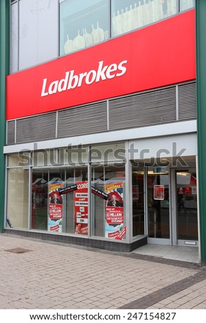 BIRMINGHAM, UK - APRIL 24, 2013: Ladbrokes betting and gaming shop in Birmingham, UK. Ladbrokes has 2,400 retail betting shops in the UK and Ireland. - stock photo