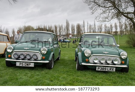 BIRMINGHAM,UK-APRIL12 2014 : Mini Coopers on display at the annual Pride of Longbridge meeting on April 12 2014 in Birmingham, UK. Any vehicle that was made at Longbridge can be displayed. - stock photo