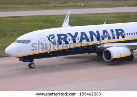 BIRMINGHAM, UK - APRIL 24, 2013: Pilots taxi Ryanair Boeing 737 at Birmingham Airport, UK. Ryanair carried 81.4 million passengers in 2013. - stock photo