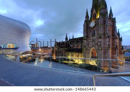 BIRMINGHAM, UK - JANUARY 30: Night scene in downtown Birmingham, UK on January 30, 2012 with the parish church St. George in the Bullring and the Selfridges Department Store. - stock photo