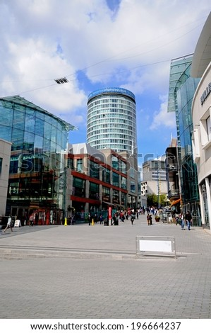 BIRMINGHAM, UK - MAY 14, 2014 - Bullring shops with the Rotunda to the rear, Birmingham, West Midlands, England, UK, Western Europe, May 14, 2014. - stock photo