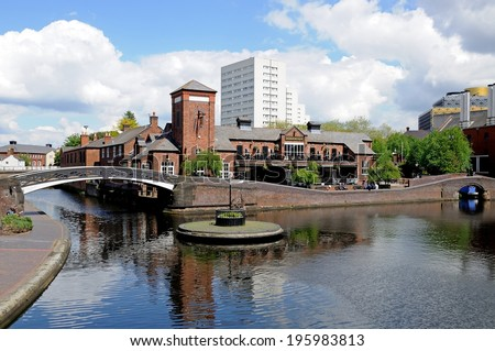 BIRMINGHAM, UK - MAY 14, 2014 - Fingerpost on an island along the canal with the Malt House Pub to the rear, Old Turn junction, Birmingham, West Midlands, England, UK, Western Europe, May 14, 2014. - stock photo
