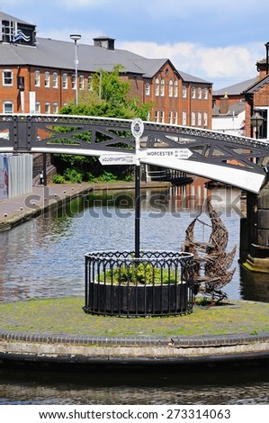 BIRMINGHAM, UNITED KINGDOM - MAY 14, 2014 - Fingerpost on an island in the centre of the canal, Old Turn junction, Birmingham, West Midlands, England, UK, Western Europe, May 14, 2014. - stock photo