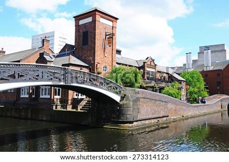 BIRMINGHAM, UNITED KINGDOM - MAY 14, 2014 - Malt House pub to the rear and footbridge along the canal, Old Turn junction, Birmingham, West Midlands, England, UK, Western Europe, May 14, 2014. - stock photo