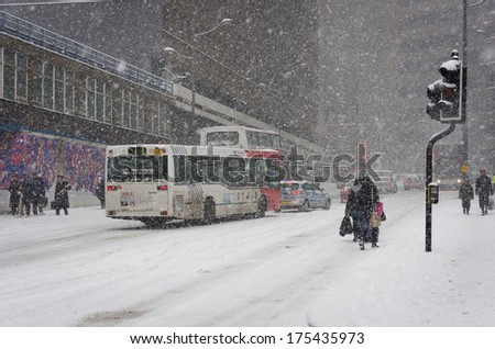 BIRMINGHAM, UNITED KINGDOM - NOVEMBER 18, 2010: Travel chaos in Birmingham UK during the winter of 2010 snowstorm which brought disruption across the UK. - stock photo