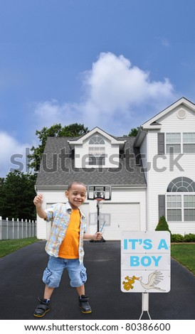 Birth Announcement it's a Boy Little Preschool Boy in Driveway of Suburban Home Residence - stock photo