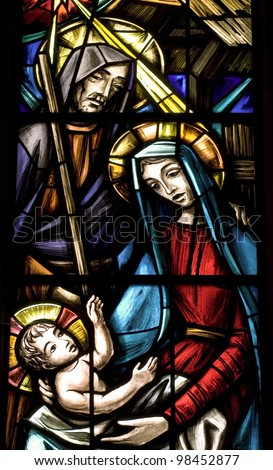 Birth of Jesus. Ancient stained glass - stock photo