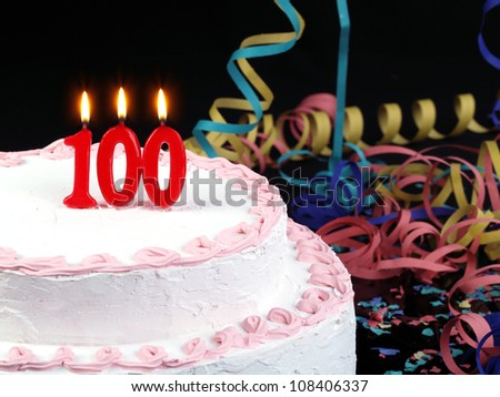 Birthday-anniversary cake with red candles showing Nr. 100 - stock photo