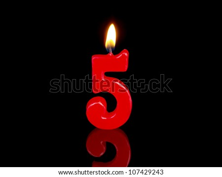Birthday-anniversary candles showing Nr. 5 - stock photo