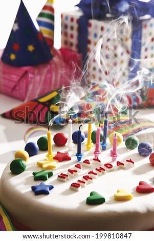 Birthday cake and presents - stock photo
