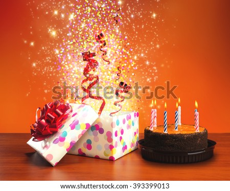Birthday cake and presents - stock photo