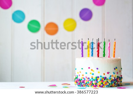 Birthday cake with blown out candles - stock photo