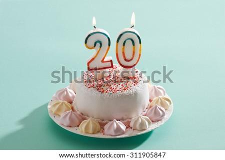 Birthday cake with burning candles - stock photo