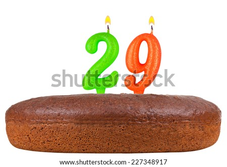birthday cake with candles number 29 isolated on white background - stock photo