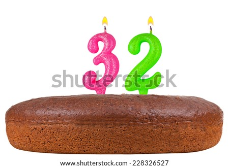 birthday cake with candles number 32 isolated on white background - stock photo