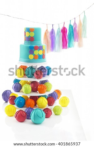 Birthday cake with decorations on white background - stock photo