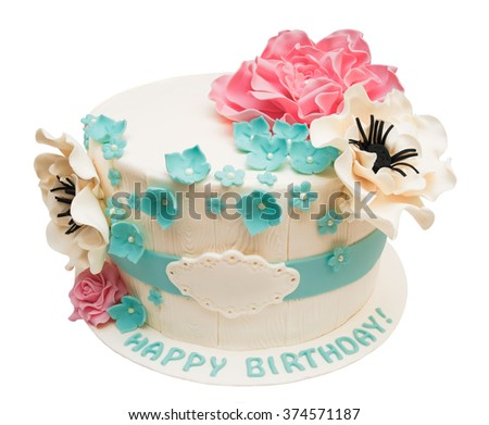 Birthday cake with flowers isolated on white with space for text or name - stock photo