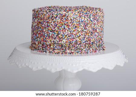 Birthday cake with sprinkles - stock photo