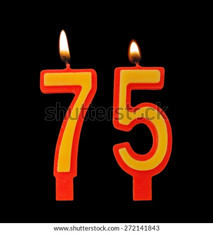 Birthday candles isolated on black background, number 75 - stock photo