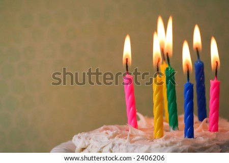 Birthday candles on a cake. - stock photo