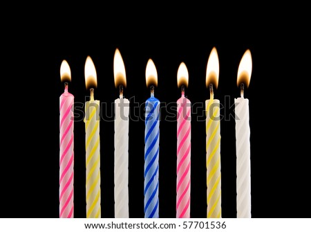 Birthday candles on black background - stock photo
