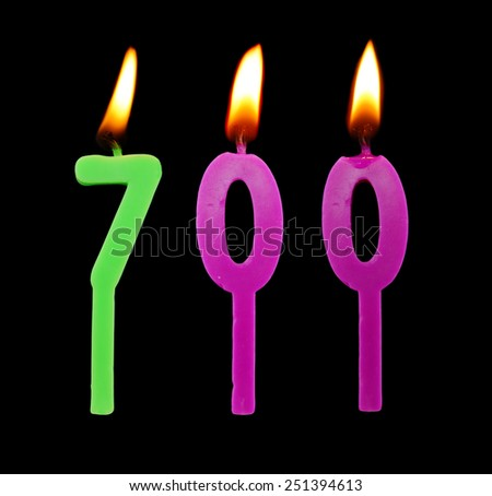 Birthday candles on black background, number 700 - stock photo