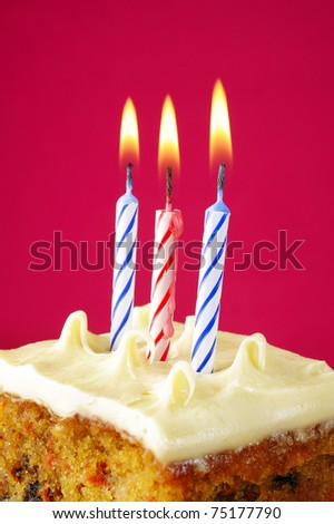 Birthday candles on pink background - stock photo