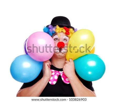 Birthday clown holding balloons on white background - stock photo