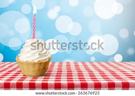 Birthday. Colorful birthday cake isolated over white - stock photo