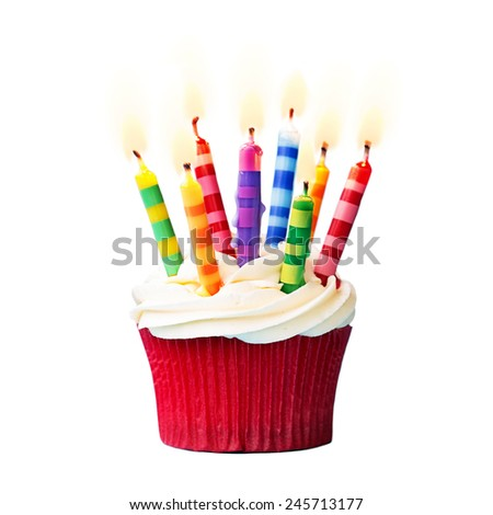 Birthday cupcake against a white background - stock photo