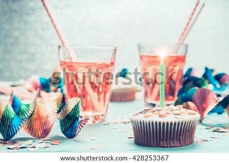 Birthday cupcake on party table - stock photo