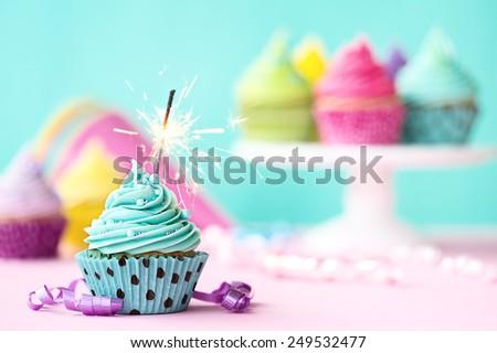 Birthday cupcake with sparkler - stock photo