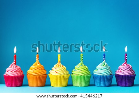 Birthday cupcakes in rainbow colors - stock photo
