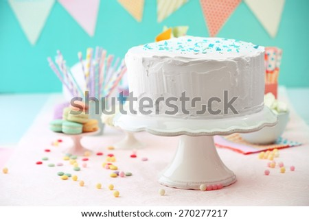 Birthday decorated cake on color background - stock photo