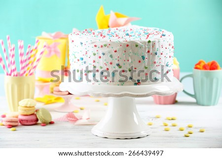 Birthday decorated cake on colorful background - stock photo