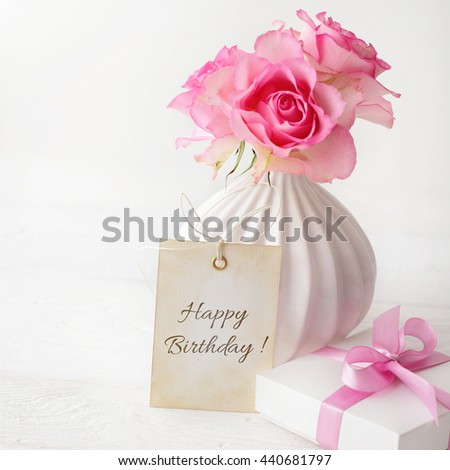 birthday gift and flowers - stock photo