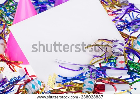 Birthday party decorations around a blank envelope - stock photo