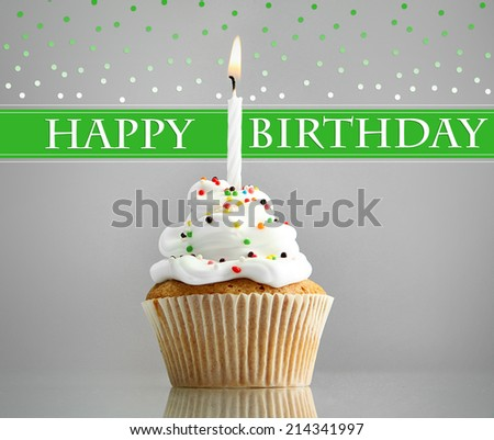 Birthday postcard.Tasty birthday cupcake with candle - stock photo