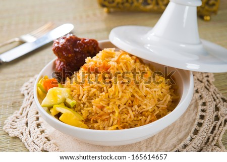 Biryani chicken rice cooked in arab style tajine with traditional india food  - stock photo