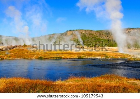Biscuit Basin In Yellowstone National Park with steam rising - stock photo