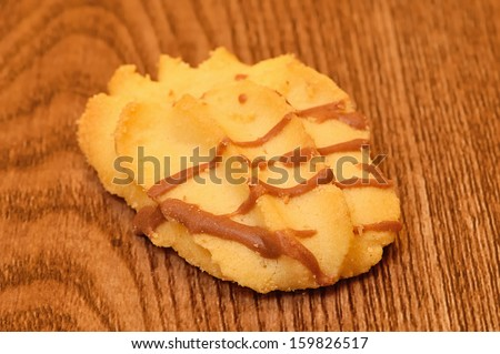 Biscuit on a wooden background - stock photo