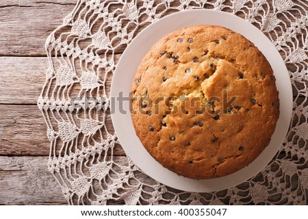 biscuit pie with chocolate Drops on a plate. horizontal view from above