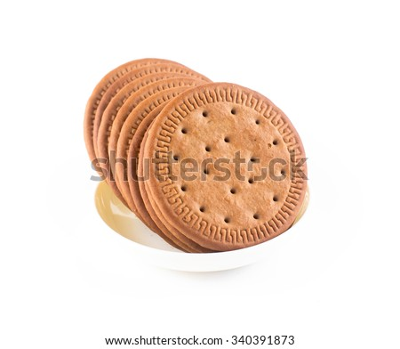 BISCUITS - A stack of delicious  round biscuits in white bowl with a few crumbs isolated on white - stock photo
