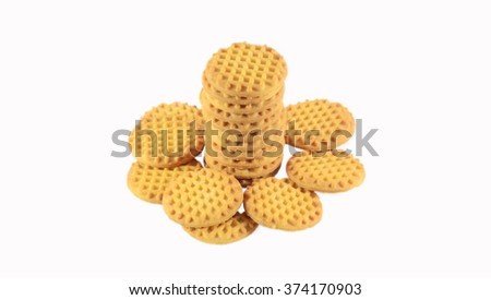 BISCUITS - A stack of delicious round biscuits isolated on white background - stock photo