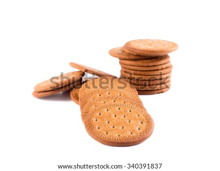 BISCUITS - A stack of delicious round biscuits with a few crumbs isolated on white - stock photo