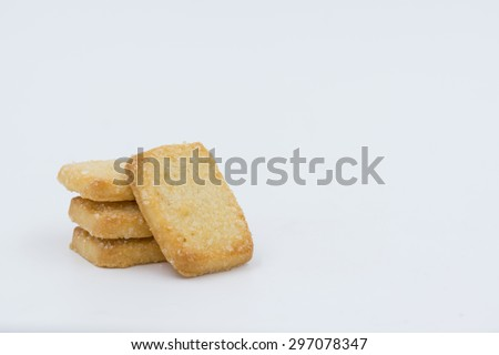 BISCUITS - A stack of delicious wheat square biscuits on white background - stock photo