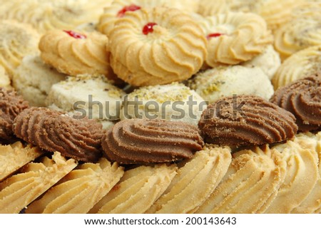 Biscuits and cookies, focus on front - stock photo