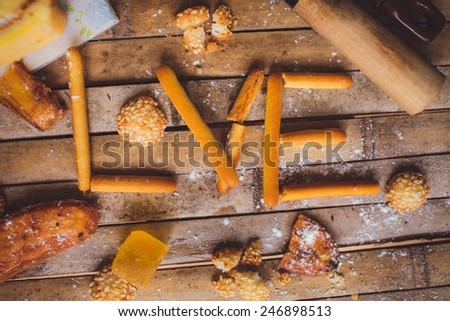 biscuits cake  lying on a brown board rustic love shaped breakfast for Valentine's Day for lovers. - stock photo