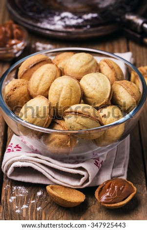 Biscuits with condensed milk in a transparent plate, close-up - stock photo