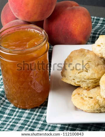 Biscuits with fresh peach jam or jelly with peaches - stock photo